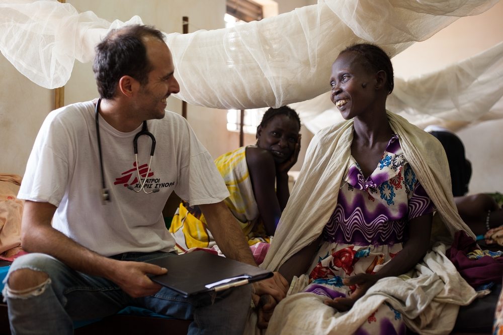 A Doctors Without Borders staff member consults a female patient in South Sudan.