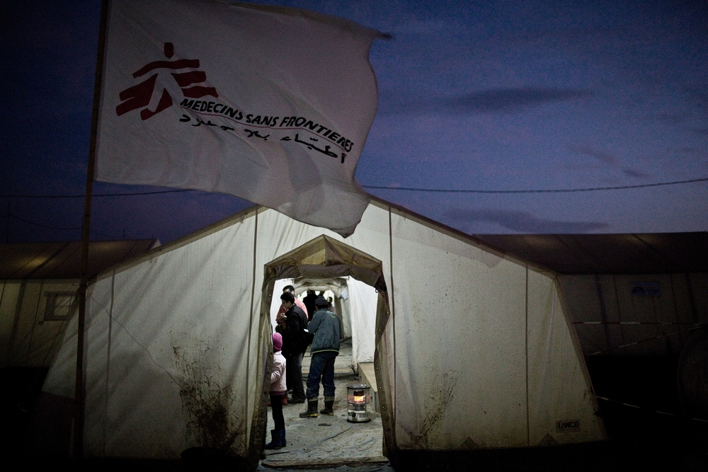 Syrian refugees assemble in a triage tent at MSF's medical clinic in Domeez camp in northwest Iraqi Kurdistan, Jan. 25, 2013.