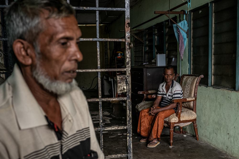 A Rohingya family in the dilapidated building where they live, in Puchong district near Kuala Lumpur.