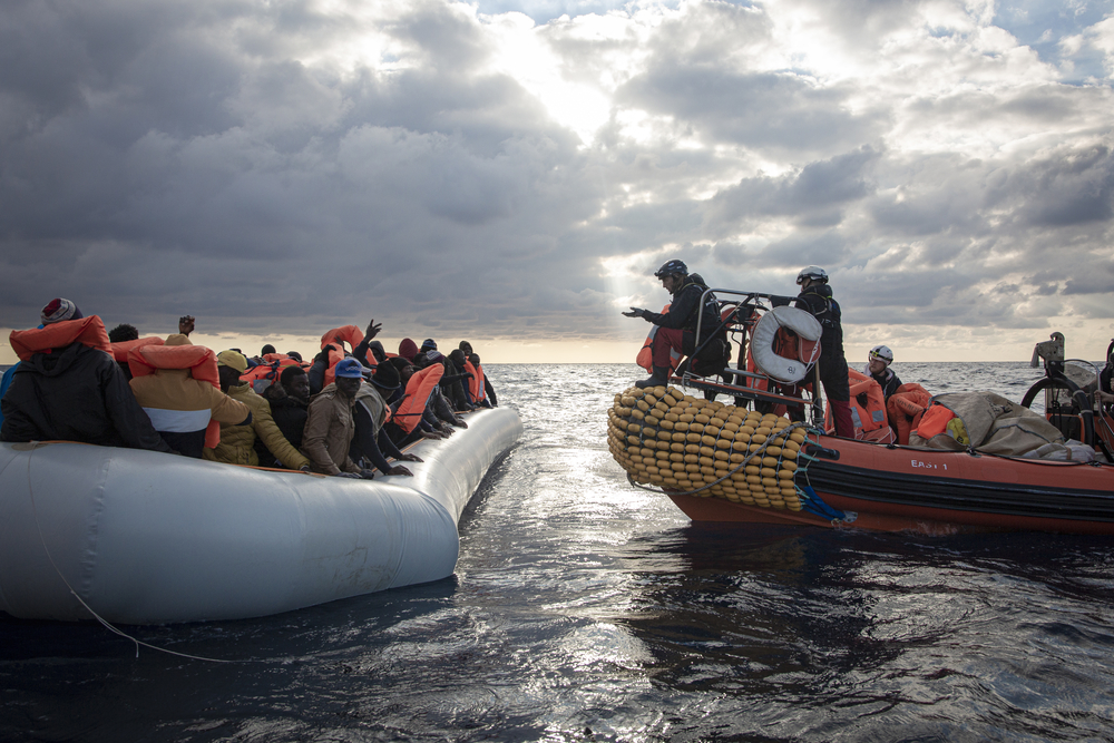 MSF and SOS MEDITERRANEE teams rescue 98 people from a fragile rubber boat in the Mediterranean on 18 February 2020