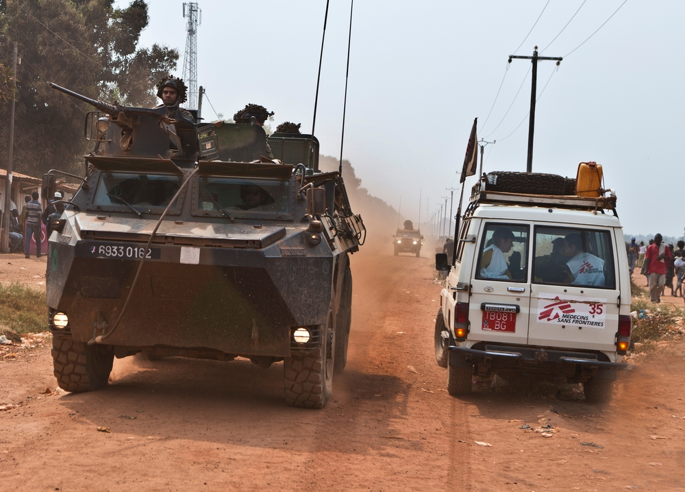 A Doctors Without Borders vehicle passes a military vehicle on the way to Castor hospital in Bangui, Central African Republic.