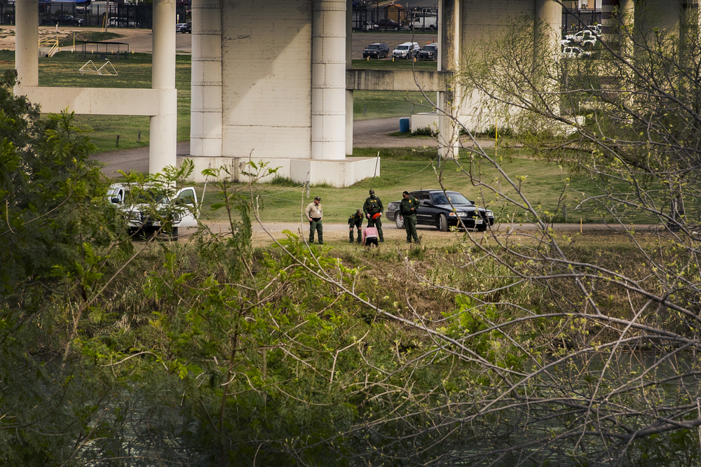 A migrant woman attempting to cross the border between Nuevo Laredo, (Mexico) and Laredo, Texas (US), is intercepted by US Border Patrol Agents.