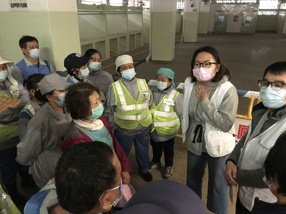 MSF teams educate street cleaners in Hong Kong about the importance of prevention measures to avoid infection with COVID-19