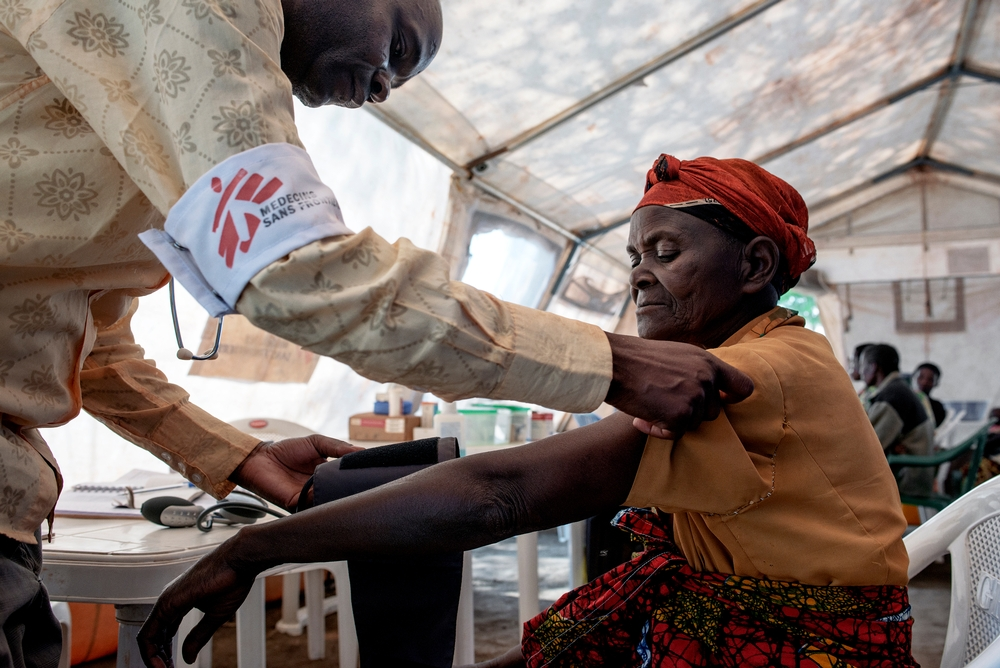 A Doctors Without Borders Mobile Clinic Medical Staff Member Consults Burundian Refugee