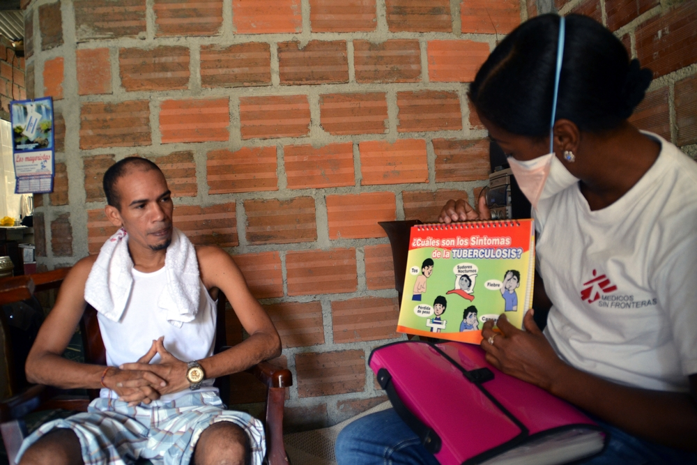 A Doctors Without Borders staff member provides tuberculosis health education to a patient.