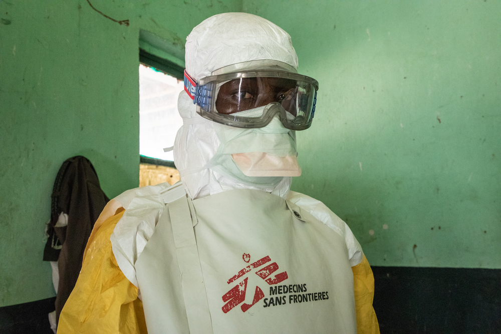 A Doctors Without Borders Staff Member Getting Dressed In Protective Suit The Ebola Treatment