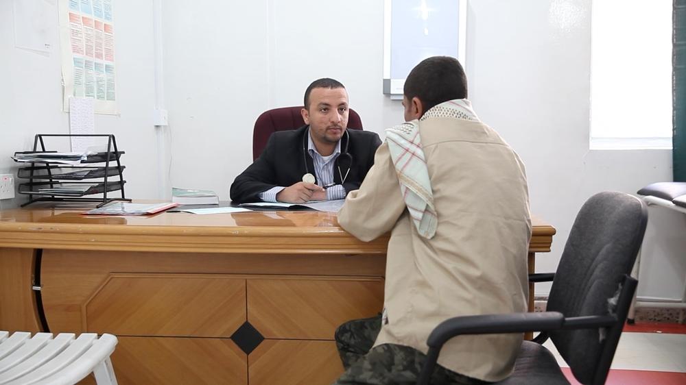 Dr Abdulfattah Al-Alimi performs a medical consultation at the HIV/AIDS treatment clinic at Al-Gumhuri hospital.