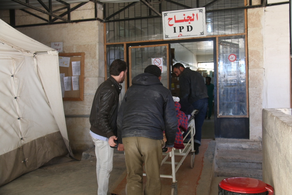 Staff from MSF's hospital in Azaz district bring a patient into the inpatient department on 17 March.