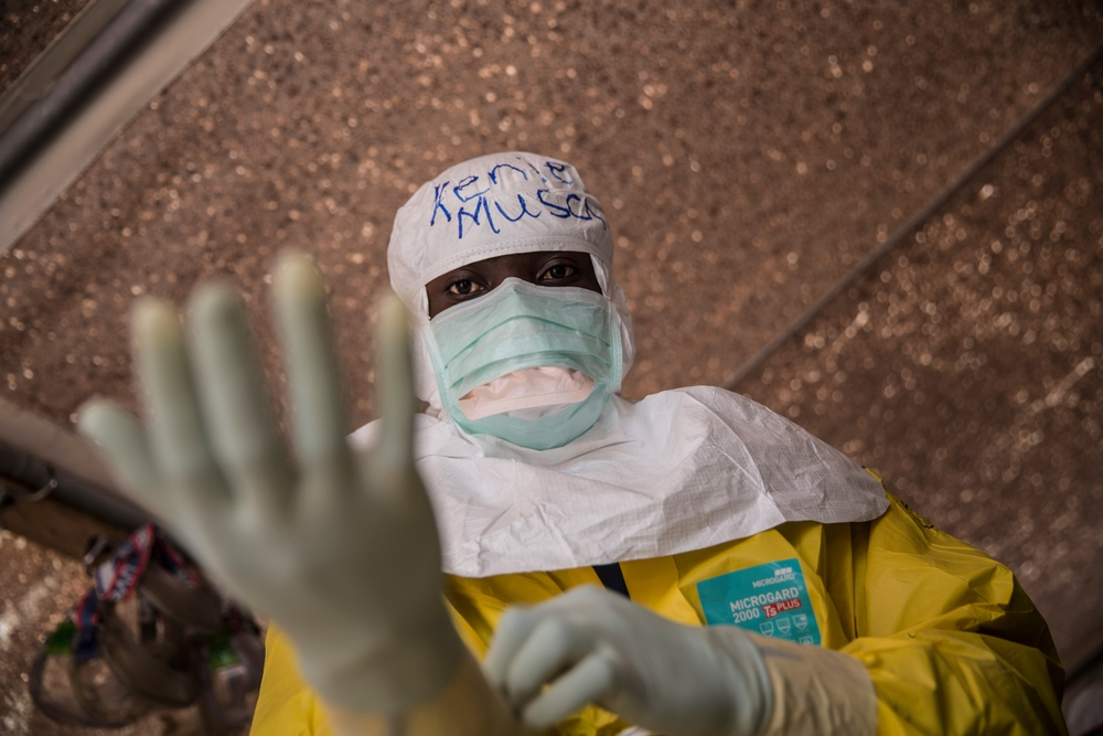 Clinical health officer Kenie Musa gets dressed in full PPE at Kailahun Ebola Treatment Centre in Sierra Leone, in December 2014