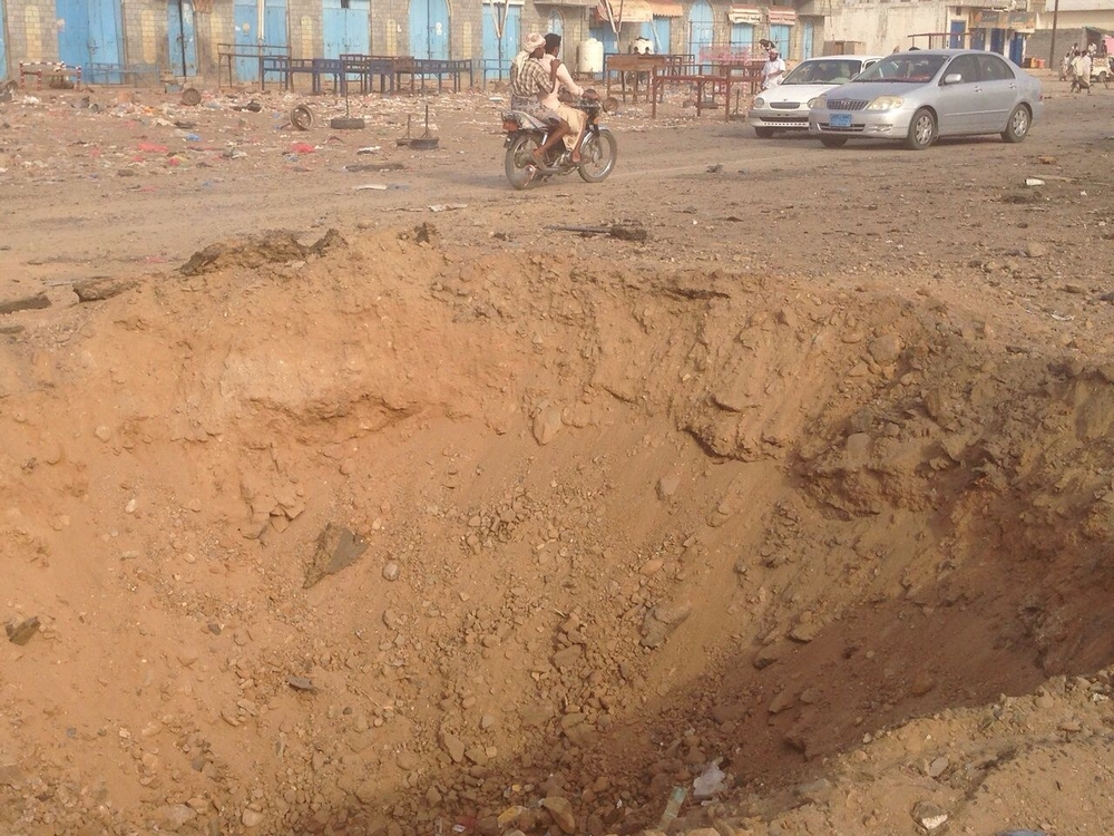 A crater caused by an explosion in Ahem Market, Yemen.