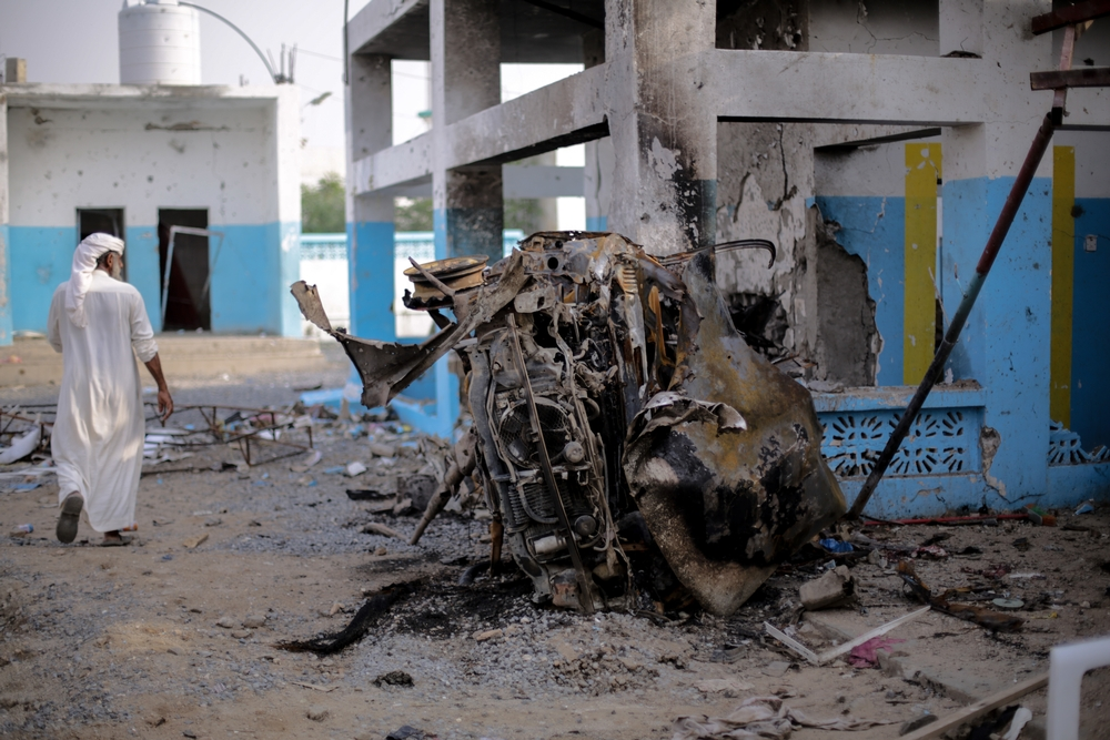 The remains of a car parked next to the emergency room during the airstrike on Abs hospital