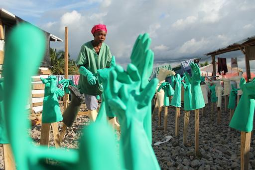 Gloves from MSF staff's personal protective equipment (PPE) are left to dry after being washed in chlorine solution.