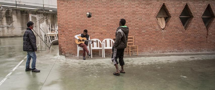 Young boys from Eritrea playing football and guitar