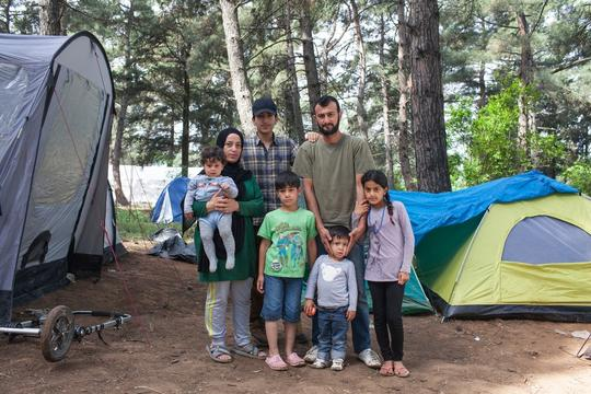 Family in refugee camp near Evzoni