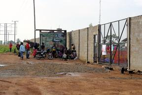 Patients wait at the gate of ELWA 3, Monrovia