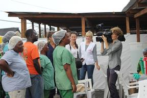 a journalist interviewing national staff in ELWA 3, Monrovia