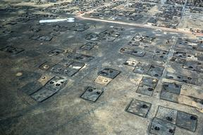 Burned dwellings in the town of Leer, South Sudan