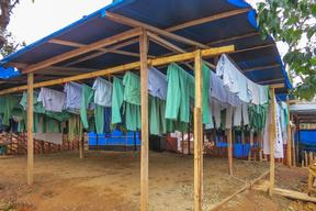 Clean scrubs dry at the Ebola case management centre in Guéckédou