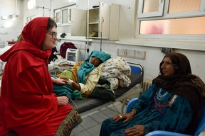 Dr Severine Caluwaerts, MSF obstetrician-gynaecologist and OCB Women's Health Advisor, talking with a mother and her daughter, a patient in Khost maternity hospital