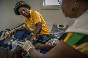 Wound care to victim of violence