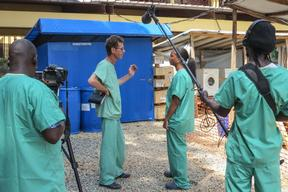 National TV crew puts on scrubs on visit to Ebola case management centre