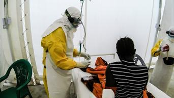 Staff attend to 16yo Ebola Patient