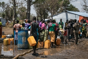 People fetching water in Palorinya refugee camp, Uganda